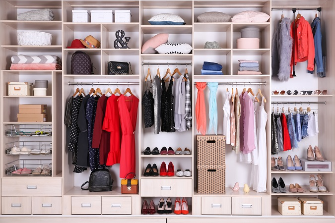 Organized closet with shelves, drawers and boxes
