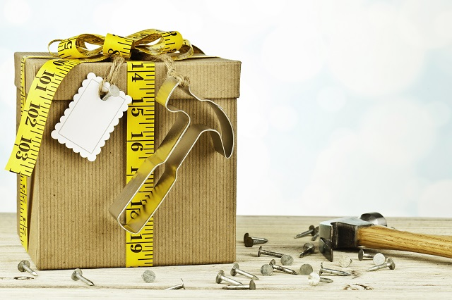 Gift with hammer decoration and gift tag nailed to gift box.