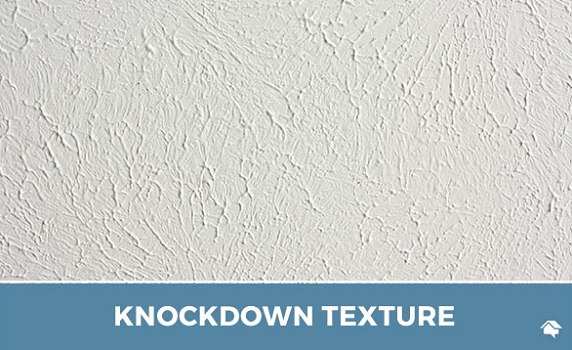 a background of sponge painted, knockdown textured white ceiling in a home