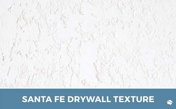 White plaster Santa Fe texture on the wall of a building