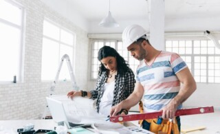 Woman managing home remodel with professional