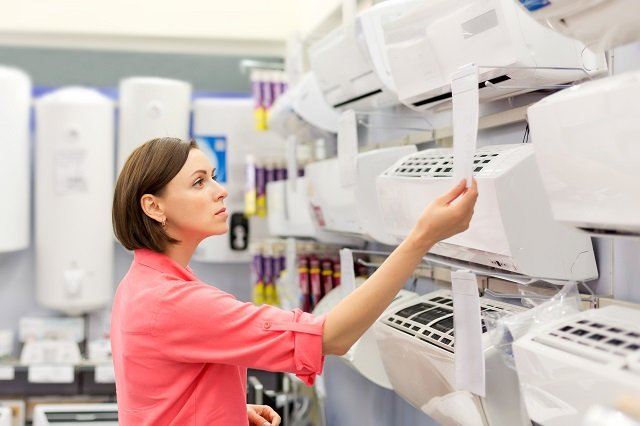 woman shopping for the best air conditioner