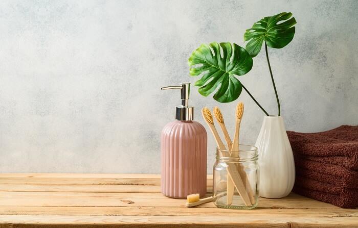 bamboo toothbrush on green eco-friendly bathroom countertop
