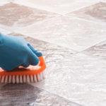 hand washing a tile floor