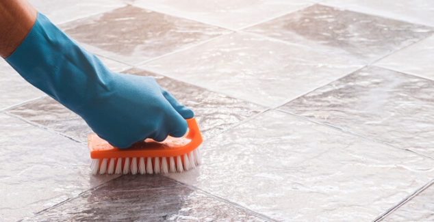 hand washing a tile floor