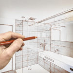 man draws plan for his bathroom remodel