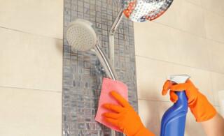 woman cleans a shower