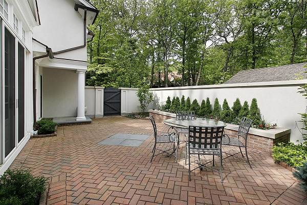 Brick patio on the side of a house
