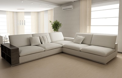 White upholstered couch in a living room