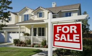beautiful house with for sale sign
