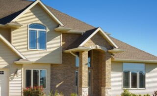 Mixed Materials House With Stone, Brick, Vinyl Siding