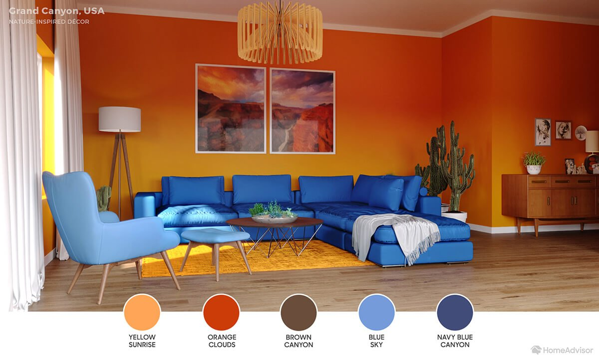Modern living room with orange walls, deep blue sectional and light blue chair.
