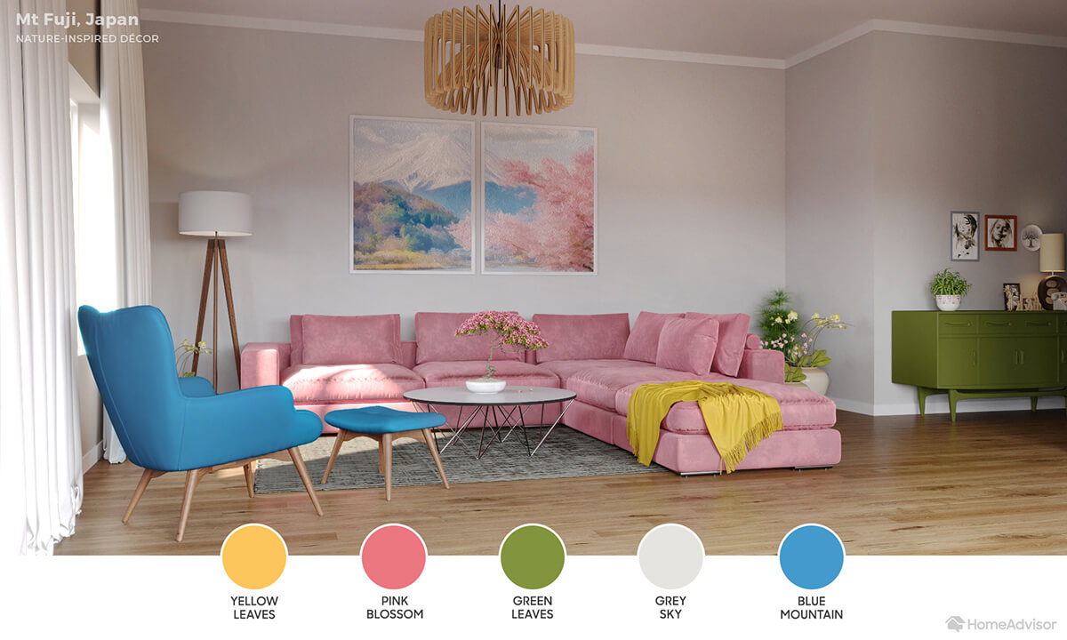Modern living room with white walls, pink sectional, blue chair and matcha green rug.