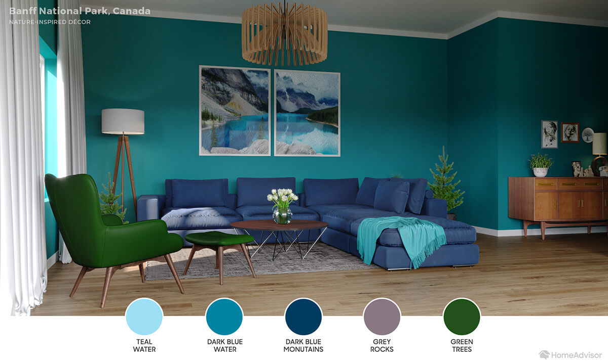 Modern living room with cool teal walls, deep blue sectional and evergreen chair.
