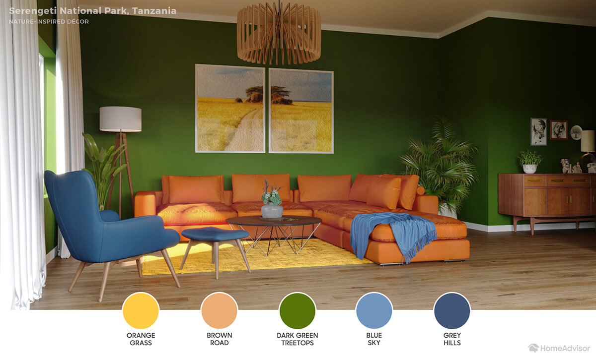 Modern living room with leafy green walls, orange sectional, golden yellow rug and sky blue throw blanket.
