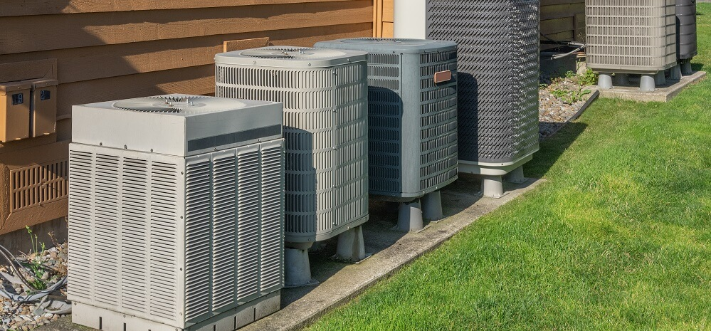 several AC units outside apartment complex