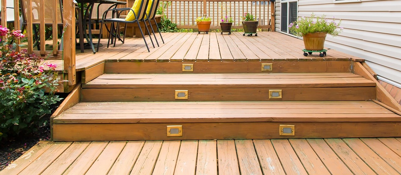 close-up of wood deck with steps and patio furniture
