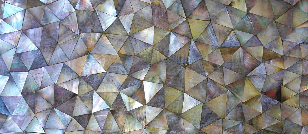 close-up of mosaic wallpaper backsplash