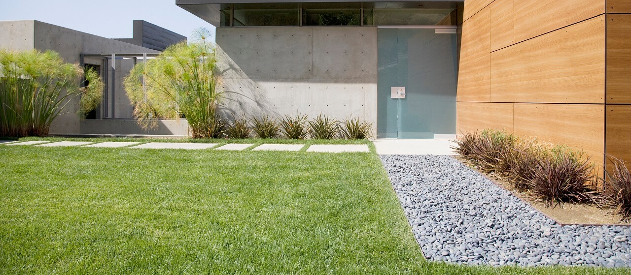 modern landscaping with a modern house