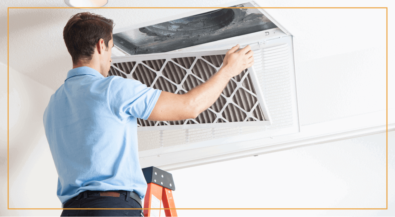 HVAC professional cleans air filters in a house