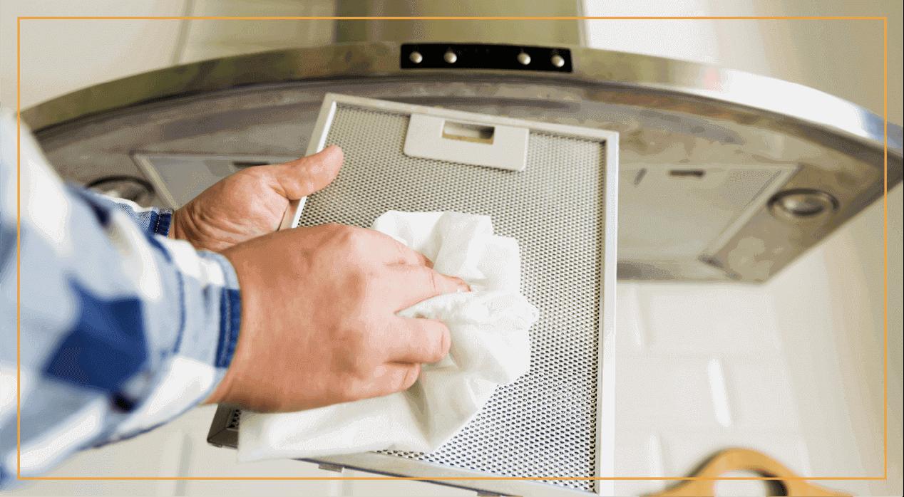 homeowner cleans hood vent filter