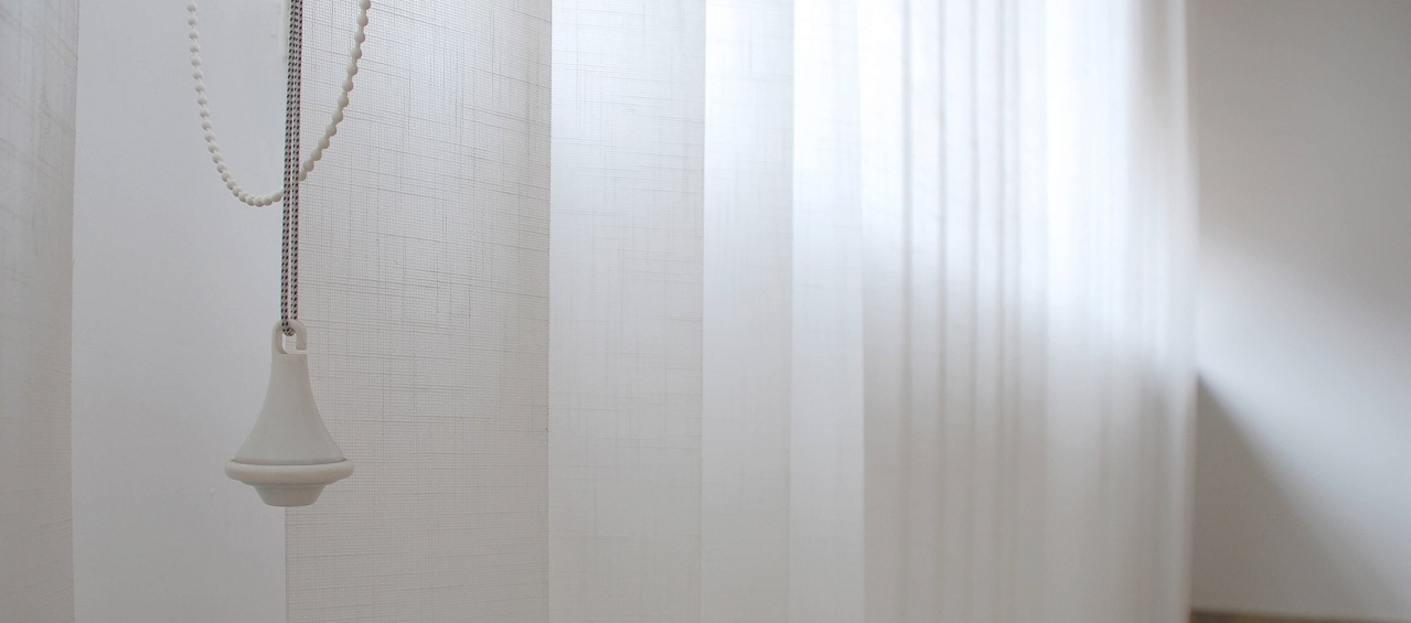 panel track blinds in a living room