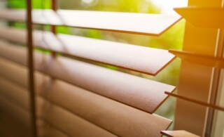 close up of wooden blinds on a residential window