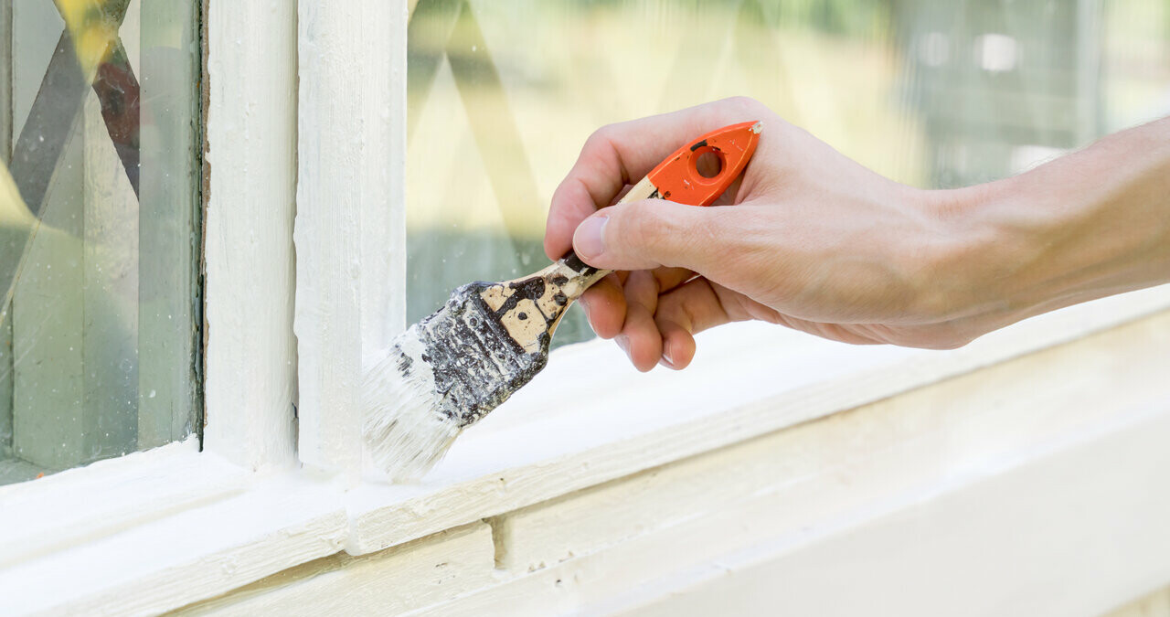 painting white paint on window sill