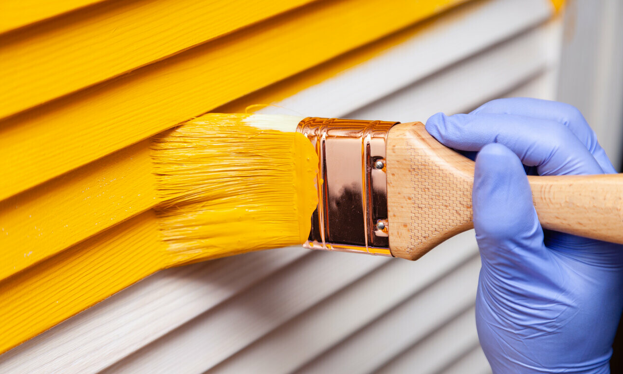 yellow paint brushed onto outdoor of home
