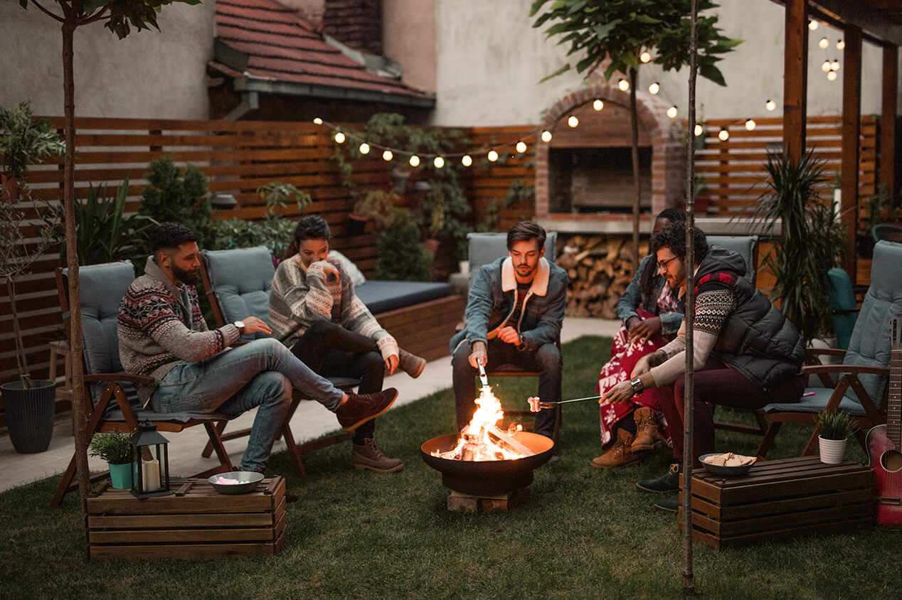 friends outside around fire pit