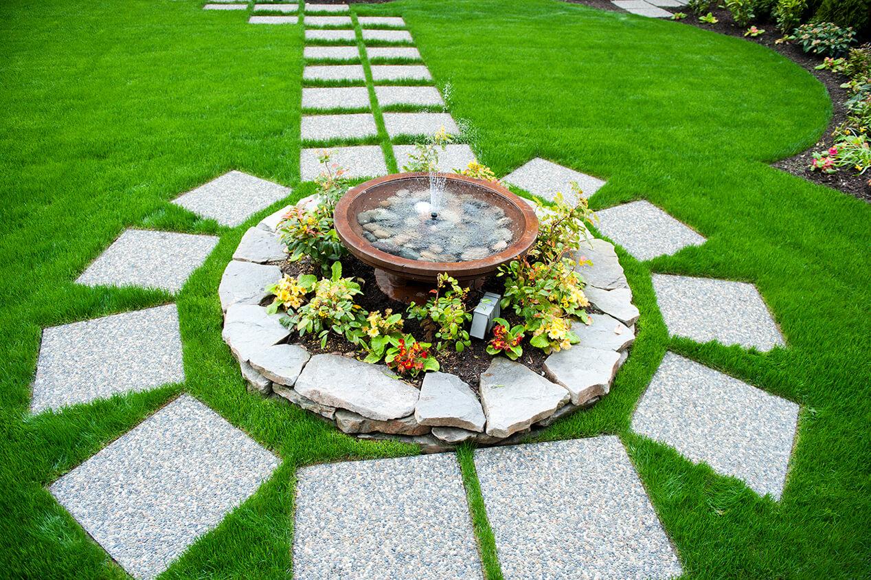 stone walkway around flowers