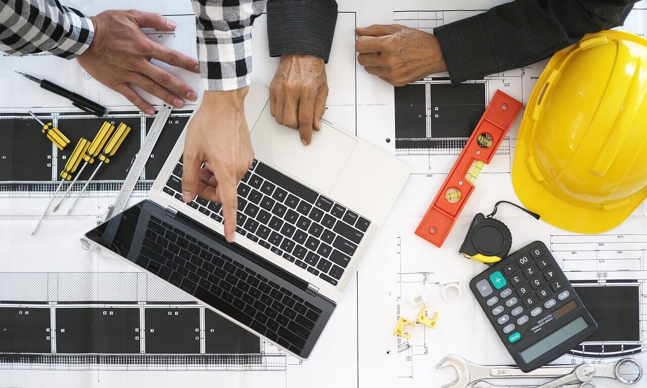 contractors planning project on a computer