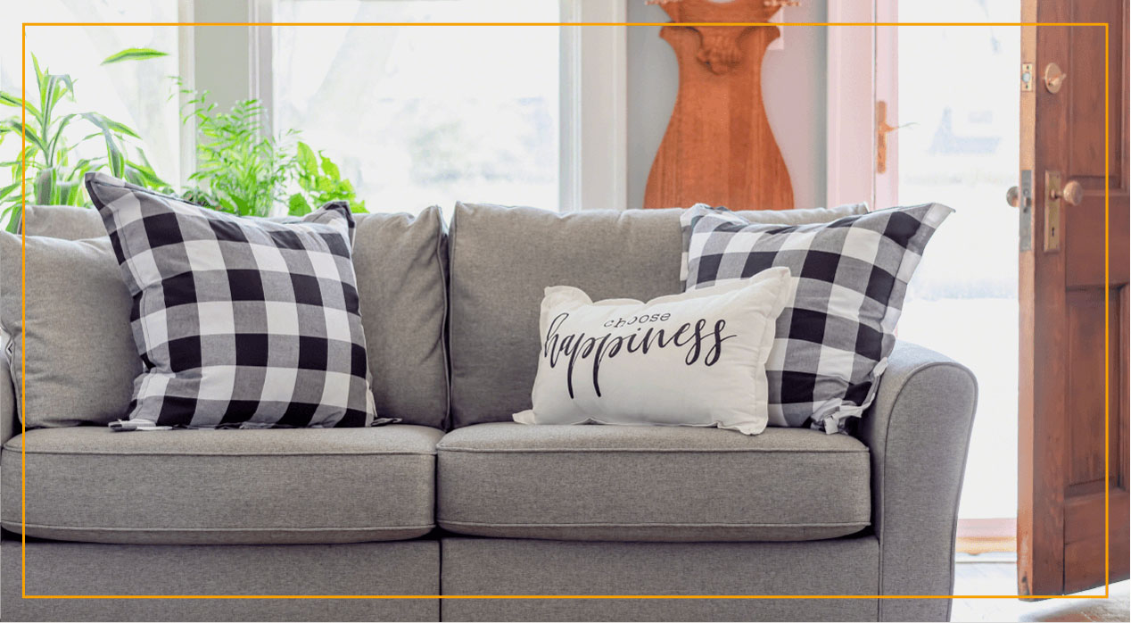 Grey couch with pillows