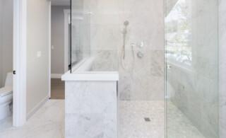white bathroom with tile shower floor