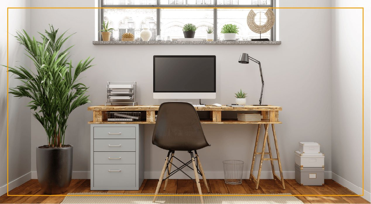 Office desk with computer and brown chair