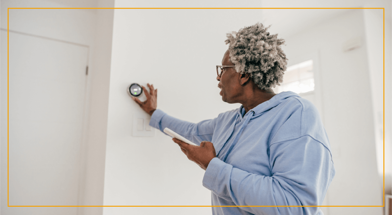 Woman changing indoor temperature