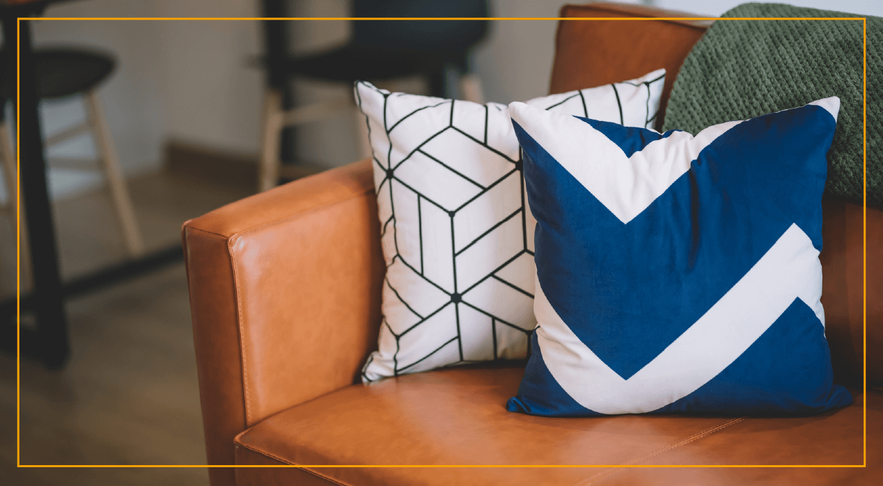 Blue and white pillows sitting on couch
