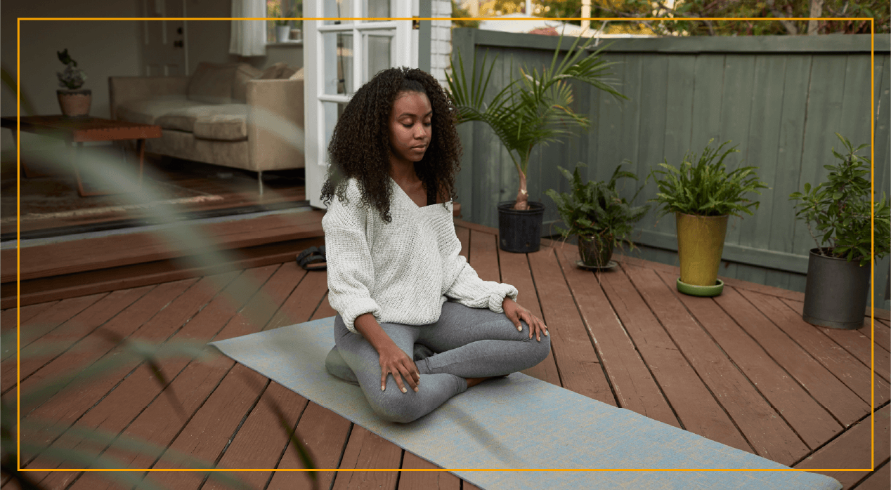 Young woman doing yoga in outdoor patio