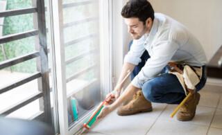 Man applying sealant to window frame