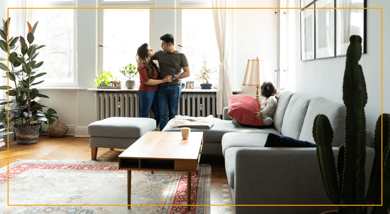 Young couple hugging in living room