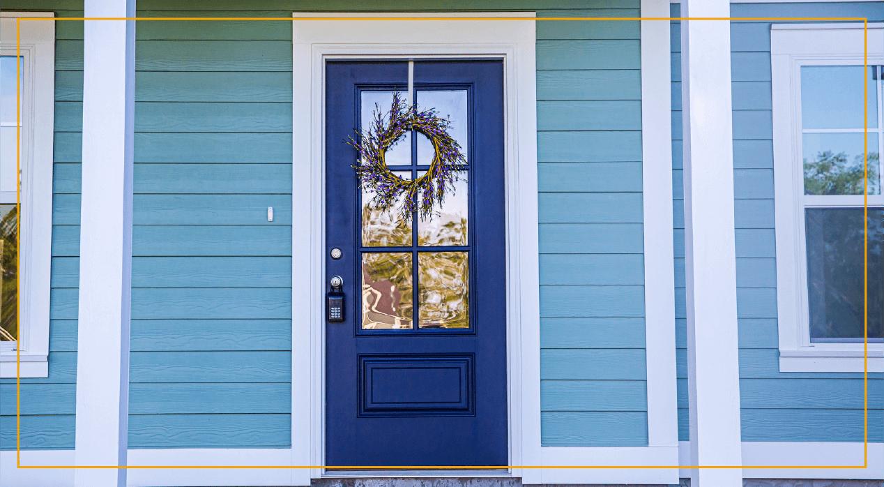 Blue door front of house