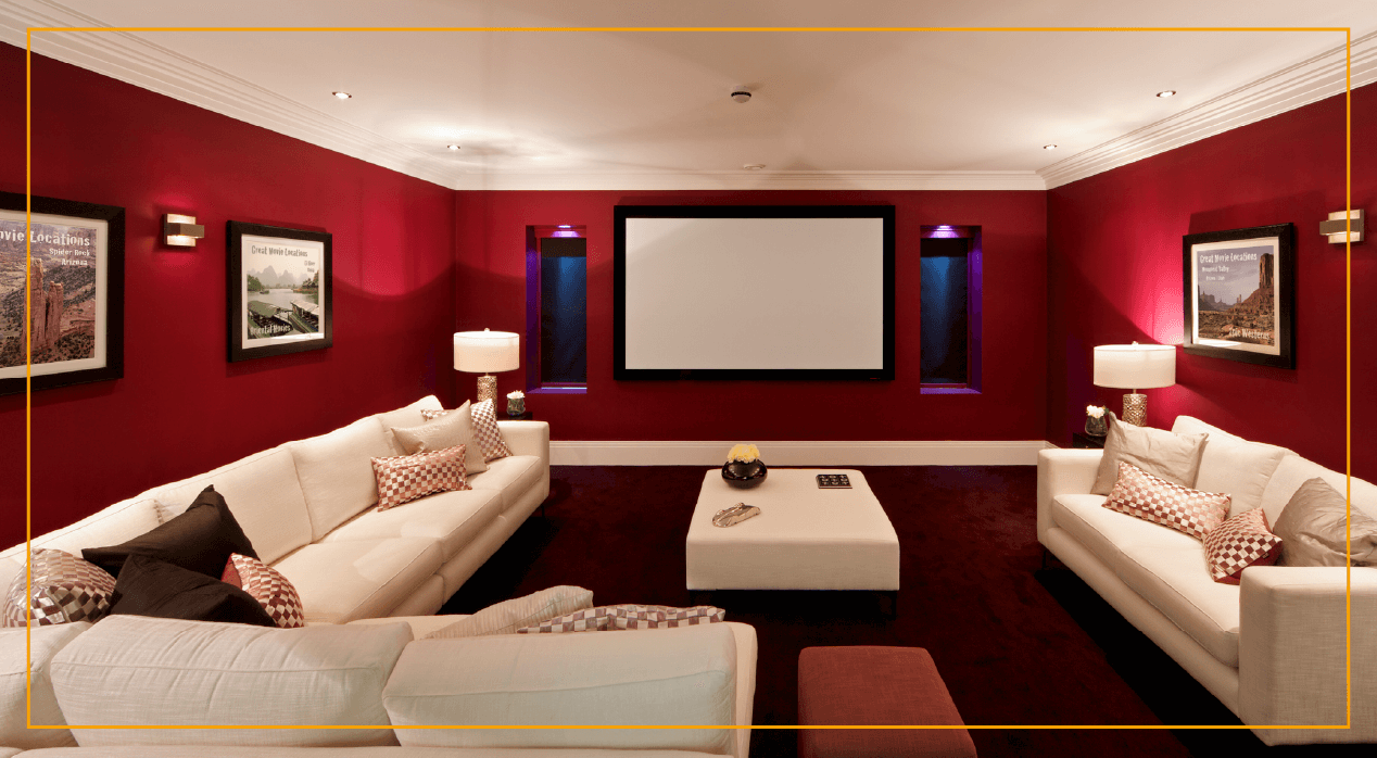basement home movie theater with red walls