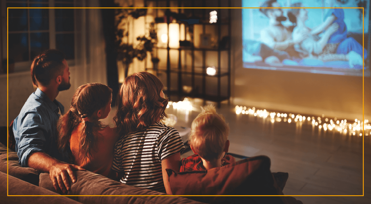 family watching projector screen