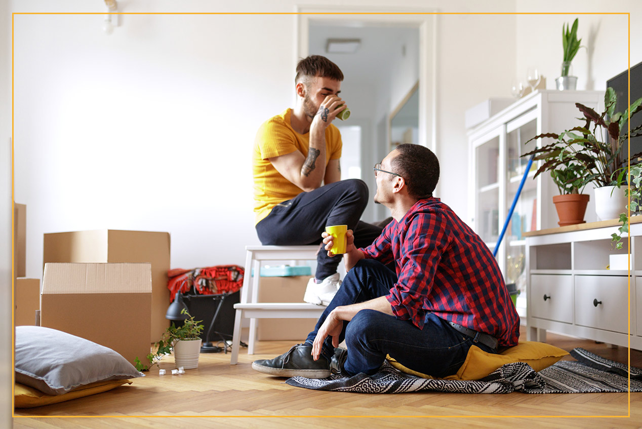 couple unpacking a box in new home