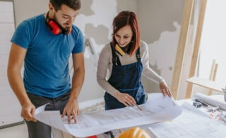 couple looking at blueprint of home