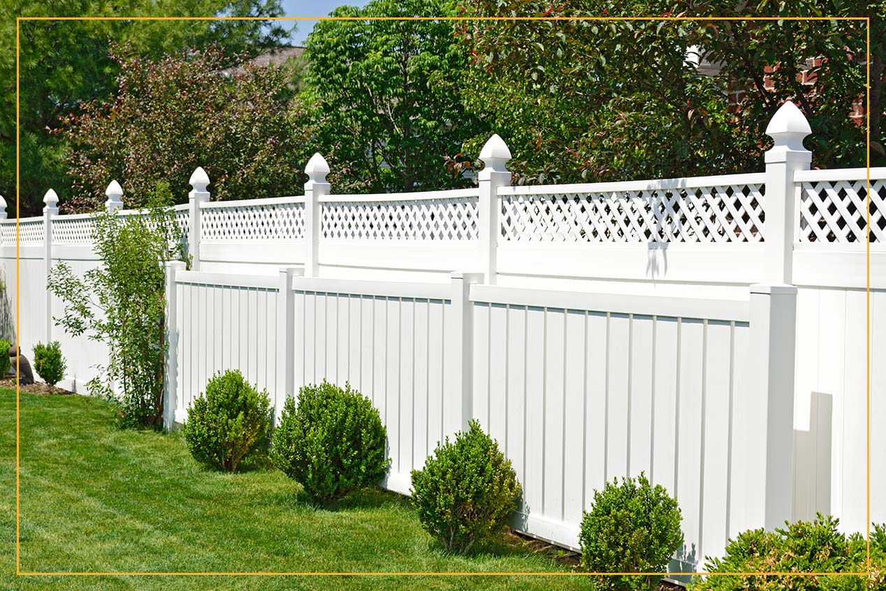 white composite fence in backyard
