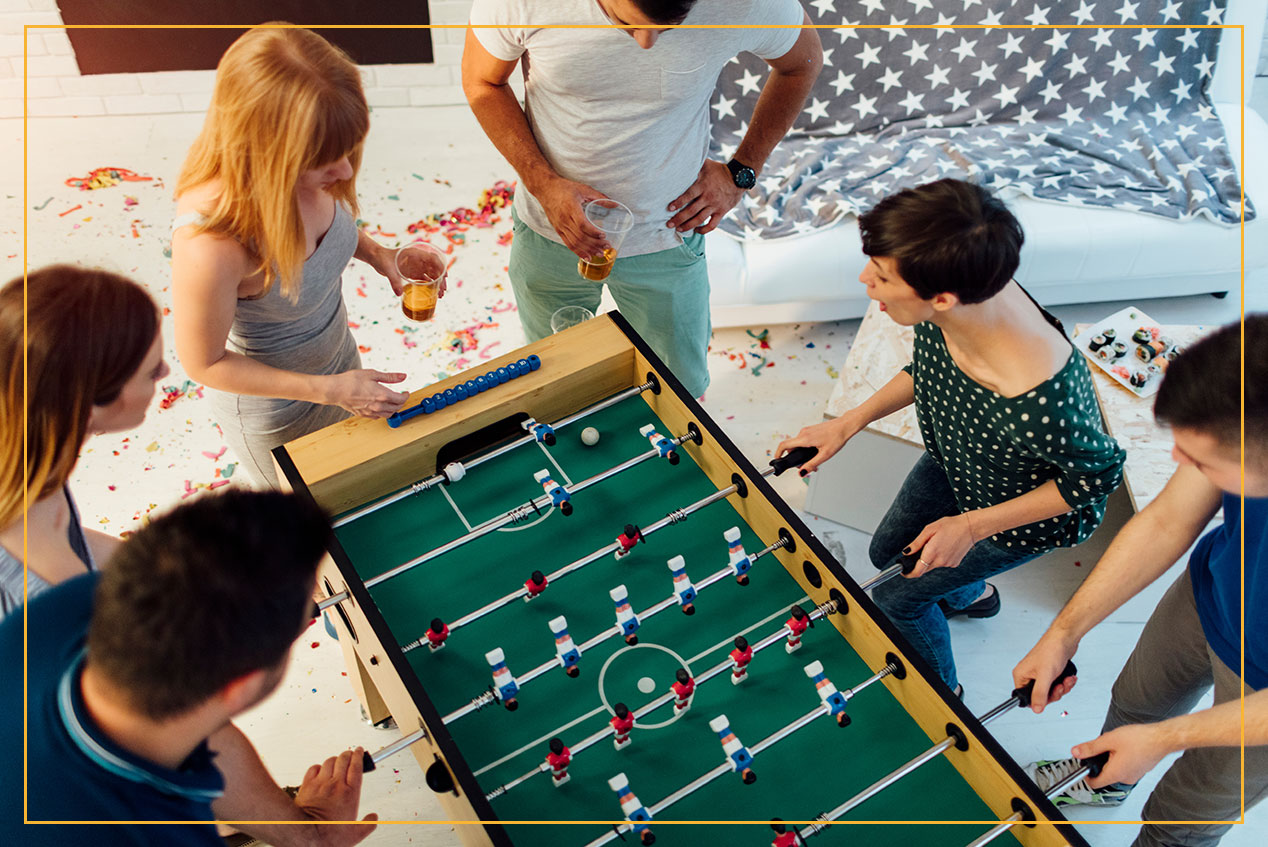 friends playing foosball