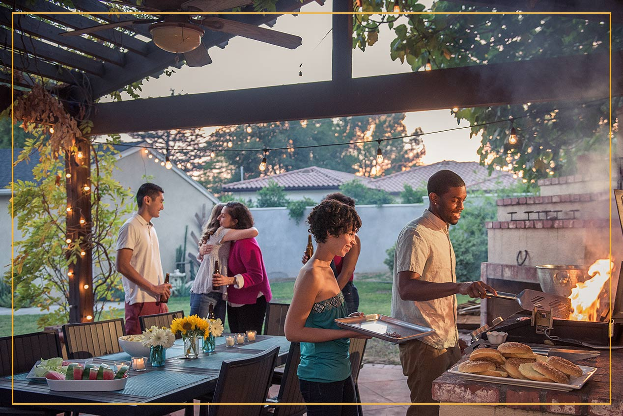 group BBQ on back patio under pergola