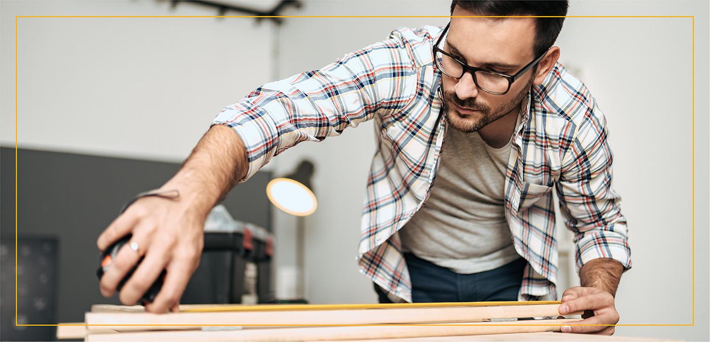 man constructing a table