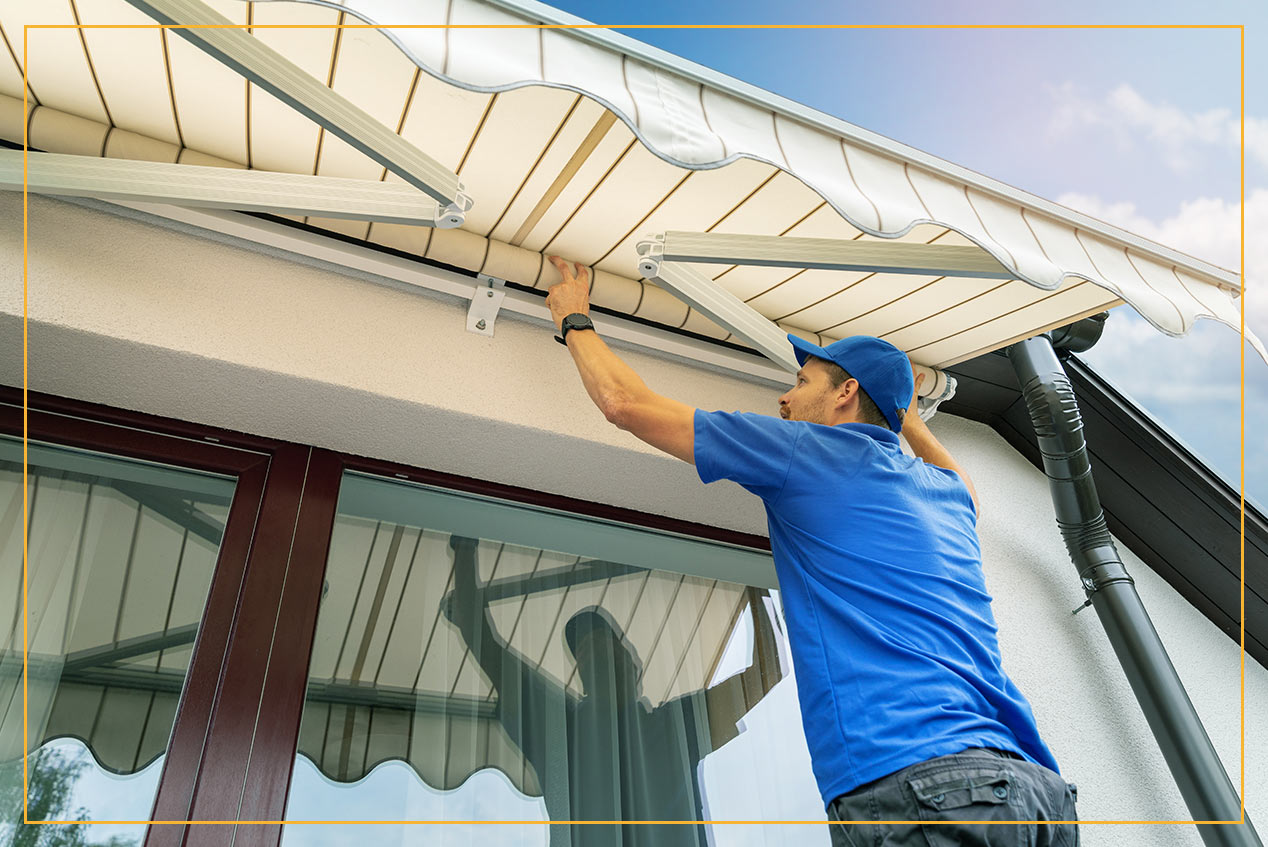 man installing retractable canopy